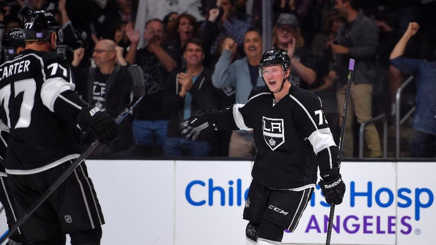 Los Angeles Kings center Tyler Toffoli, right, celebrates his goal with Los Angeles Kings center Jeff Carter during the second period of an NHL hockey game against the Columbus Blue Jackets, Sunday, Oct. 26, 2014, in Los Angeles. (AP Photo/Mark J. Terrill)