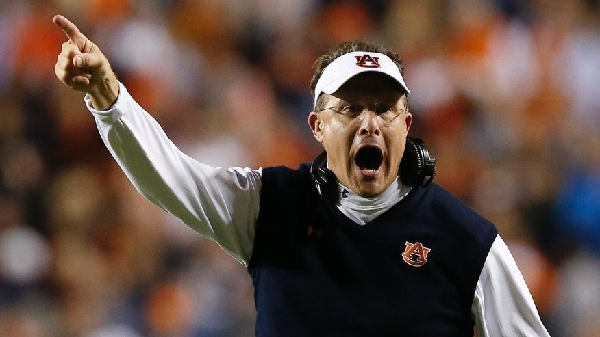 Auburn coach Gus Malzahn yells to an official during the second half of an NCAA college football game against South Carolina on Saturday, Oct. 25, 2014, in Auburn, Ala. Auburn won 42-35. (AP Photo/Brynn Anderson)
