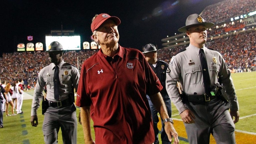 South Carolina coach Steve Spurrier walks off the field after the team's 42-35 loss to Auburn in an NCAA college football game on Saturday, Oct. 25, 2014, in Auburn, Ala. (AP Photo/Butch Dill)