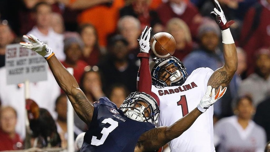 Auburn defensive back Jonathan Jones (3) breaks up a pass to South Carolina wide receiver Damiere Byrd (1) during the second half of an NCAA college football game Saturday, Oct. 25, 2014, in Auburn, Ala. Auburn won 42-35. (AP Photo/Brynn Anderson)