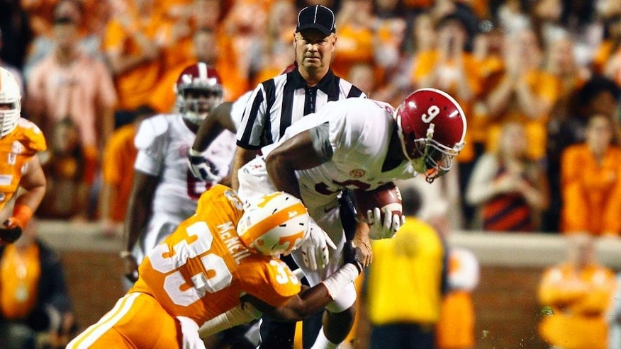 Alabama running back T.J. Yeldon (4) runs for yardage in the first quarter of an NCAA college football game against Tennessee, Saturday, Oct. 25, 2014 in Knoxville, Tenn. (AP Photo/Wade Payne)