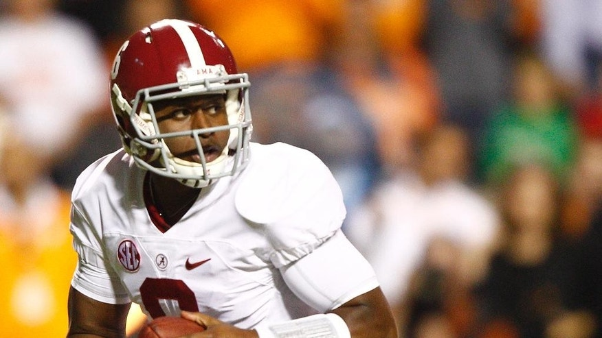Alabama quarterback Blake Sims (6) looks for a receiver in the first quarter of an NCAA college football game against Tennessee, Saturday, Oct. 25, 2014 in Knoxville, Tenn. (AP Photo/Wade Payne)