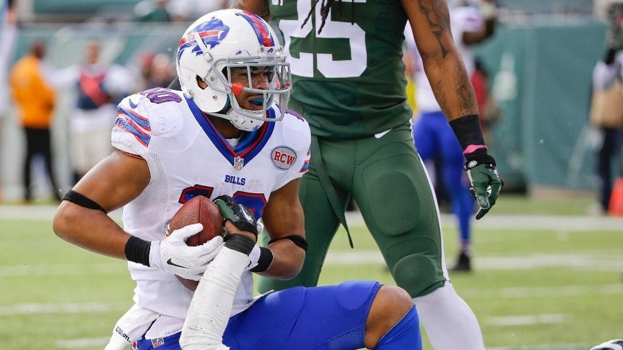 Buffalo Bills wide receiver Robert Woods (10) reacts after being tackled in the end zone by New York Jets cornerback Antonio Allen (39) for a touchdown during the first half of an NFL football game Sunday, Oct. 26, 2014, in East Rutherford, N.J. (AP Photo/Seth Wenig)