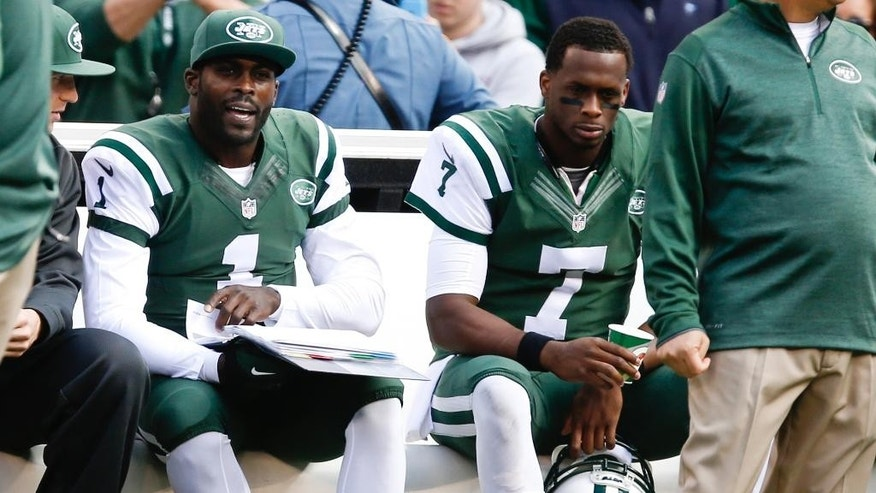 New York Jets quarterback Geno Smith (7) and Michael Vick (1) sit on the bench during the first half of an NFL football game against the Buffalo Bills, Sunday, Oct. 26, 2014, in East Rutherford, N.J. (AP Photo/Kathy Willens)