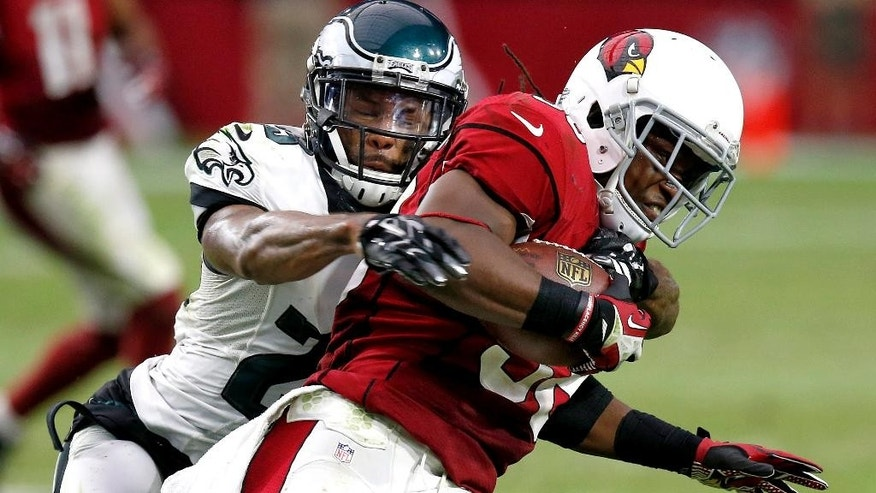 Arizona Cardinals running back Andre Ellington, right, is tackled by Philadelphia Eagles cornerback Nolan Carroll during the second half of an NFL football game, Sunday, Oct. 26, 2014, in Glendale, Ariz. (AP Photo/Ross D. Franklin)