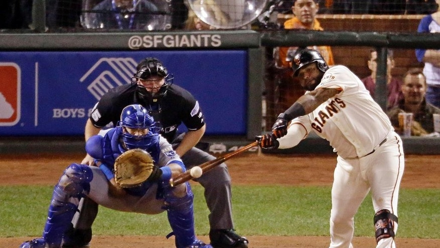 San Francisco Giants' Pablo Sandoval hits a two run RBI single during the sixth inning of Game 4 of baseball's World Series against the Kansas City Royals on Saturday, Oct. 25, 2014, in San Francisco. (AP Photo/Charlie Riedel)