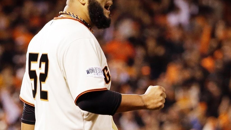 San Francisco Giants pitcher Yusmeiro Petit reacts after getting Kansas City Royals' Norichika Aoki to ground into a double play during the sixth inning of Game 4 of baseball's World Series Saturday, Oct. 25, 2014, in San Francisco. (AP Photo/David J. Phillip)