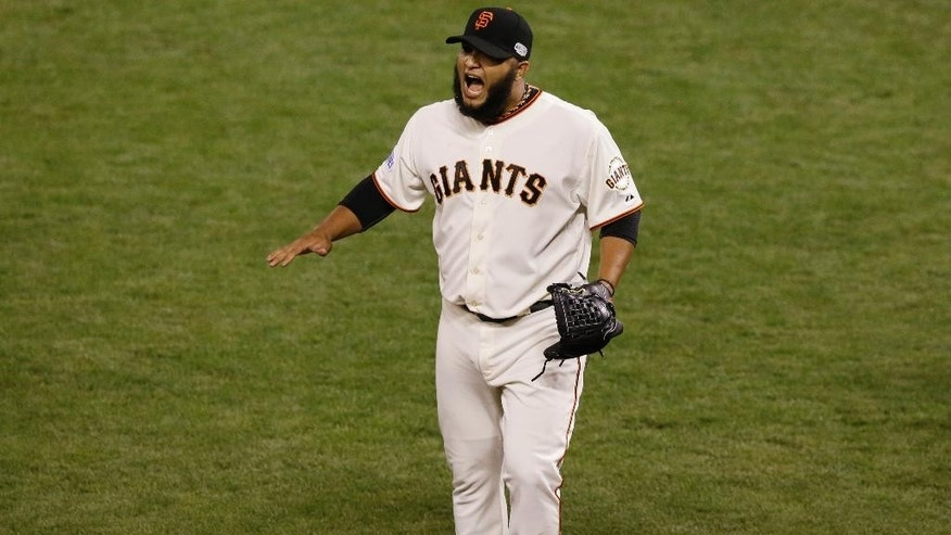 San Francisco Giants pitcher Yusmeiro Petit reacts after the sixth inning of Game 4 of baseball's World Series against the Kansas City Royals Saturday, Oct. 25, 2014, in San Francisco. (AP Photo/Jeff Chiu)