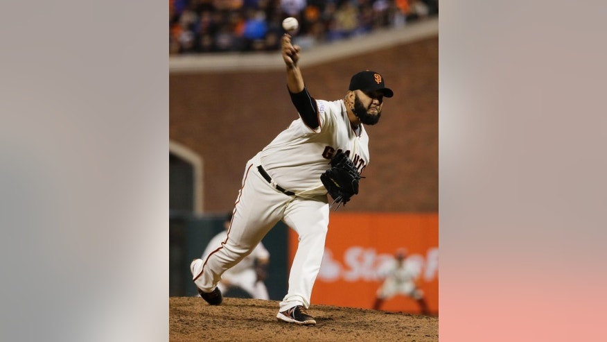 San Francisco Giants pitcher Yusmeiro Petit pitches during the fourth inning of Game 4 of baseball's World Series against the Kansas City Royals Saturday, Oct. 25, 2014, in San Francisco. (AP Photo/Matt Slocum)
