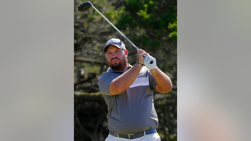 Brendon de Jonge, of Zimbabwe, hits off the second tee during the final round of the McGladrey Classic golf tournament on Sunday, Oct. 26, 2014, in St. Simons Island, Ga. (AP Photo/Stephen B. Morton)