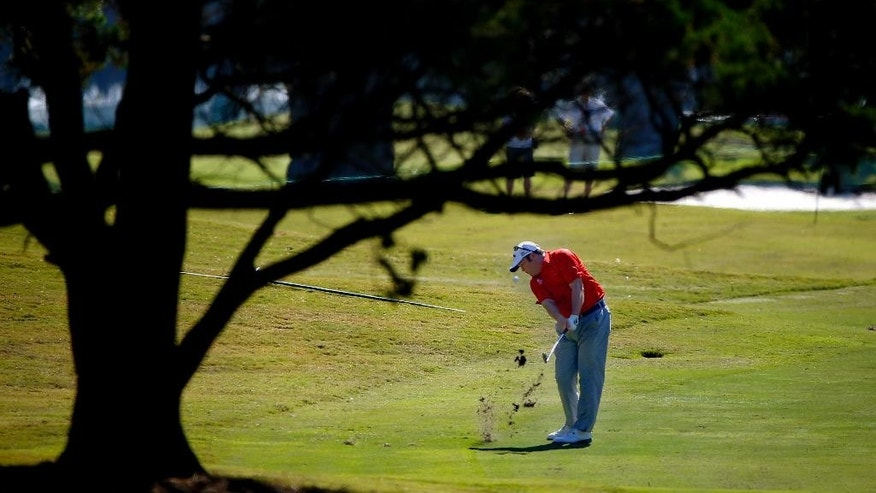 Andrew Svoboda hits his ball on the first fairway during the final round of the McGladrey Classic golf tournament on Sunday, Oct. 26, 2014, in St. Simons Island, Ga. (AP Photo/Stephen B. Morton)