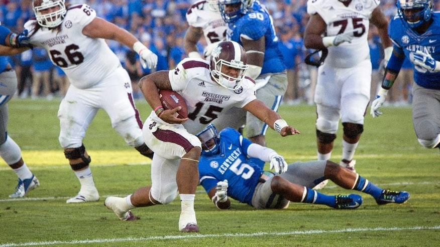 Mississippi State quarterback Dak Prescott crosses the goal line for a touchdown during the second half of an NCAA college football game against Kentucky at Commonwealth Stadium in Lexington, Ky., Saturday, Oct. 25, 2014. Mississippi State won 45-31. (AP Photo/David Stephenson)