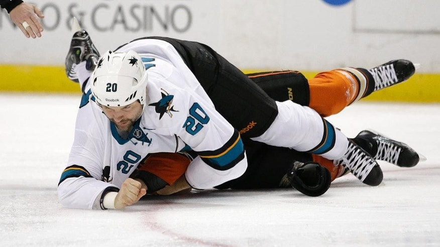 San Jose Sharks' John Scott, top, fights with Anaheim Ducks' Tim Jackman during the first period of an NHL hockey game Sunday, Oct. 26, 2014, in Anaheim, Calif. (AP Photo/Jae C. Hong)