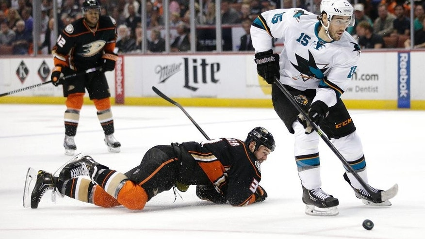 San Jose Sharks' James Sheppard, right, controls the puck past Anaheim Ducks' Clayton Stoner during the first period of an NHL hockey game Sunday, Oct. 26, 2014, in Anaheim, Calif. (AP Photo/Jae C. Hong)