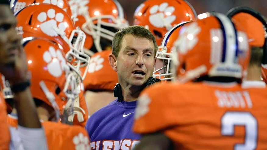 Clemson head coach Dabo Swinney talks to his team during the first half an NCAA college football game against Syracuse in Clemson, S.C.,  Saturday, Oct. 25, 2014. (AP Photo/ Richard Shiro)