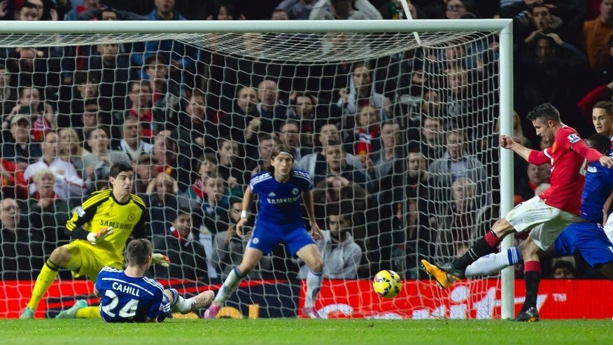 Manchester United's Robin van Persie, right, scores against Chelsea during the English Premier League soccer match between Manchester United and Chelsea at Old Trafford Stadium, Manchester, England, Sunday Oct. 26, 2014. (AP Photo/Jon Super)