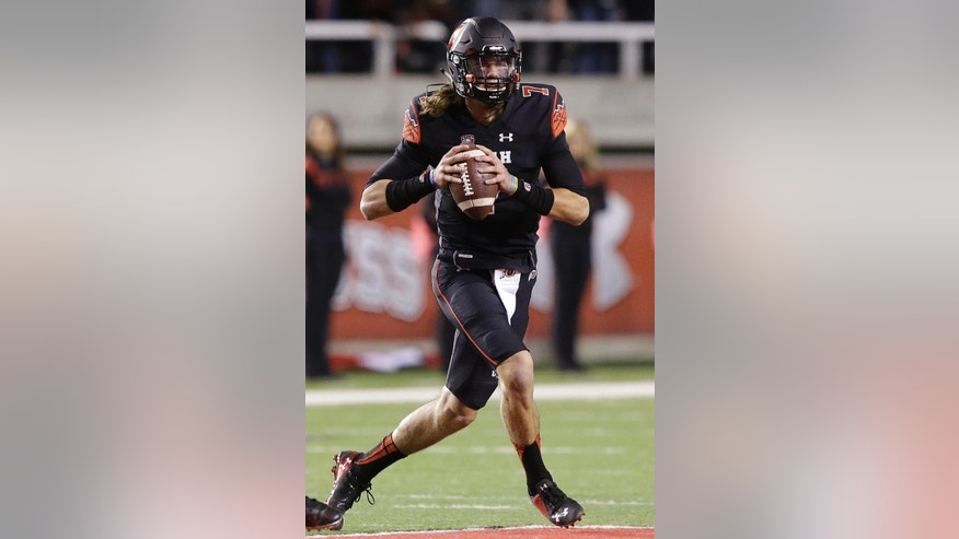 Utah quarterback Travis Wilson looks for a receiver during the first quarter of an NCAA college football game against Southern California on Saturday, Oct. 25, 2014, in Salt Lake City. (AP Photo/Rick Bowmer)