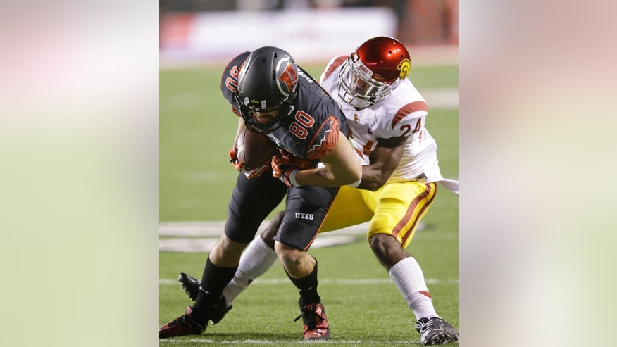 Southern California safety John Plattenburg (24) tackles Utah tight end Westlee Tonga (80) during the first quarter of an NCAA college football game Saturday, Oct. 25, 2014, in Salt Lake City. (AP Photo/Rick Bowmer)
