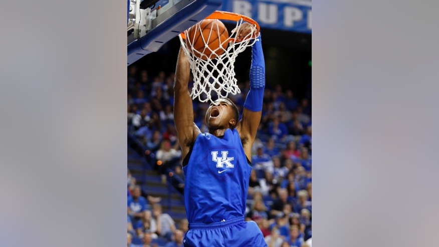The Blue squads' Andrew Harrison dunks during Kentucky's intrasquad NCAA college basketball scrimmage, Monday, Oct. 27, 2014, in Lexington, Ky. (AP Photo/James Crisp)