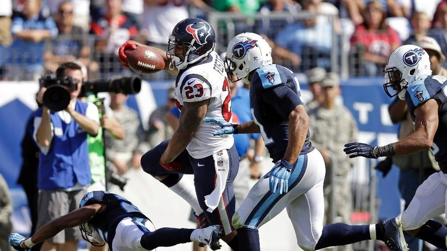 Houston Texans running back Arian Foster (23) scores a touchdown on a 34-yard run against the Tennessee Titans in the second quarter of an NFL football game Sunday, Oct. 26, 2014, in Nashville, Tenn. (AP Photo/Wade Payne)