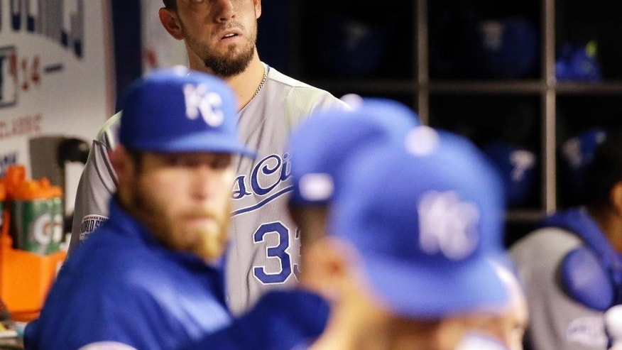 Kansas City Royals pitcher James Shields looks out of the dugout during the fifth inning of Game 5 of baseball's World Series against the San Francisco Giants Sunday, Oct. 26, 2014, in San Francisco. (AP Photo/David J. Phillip)