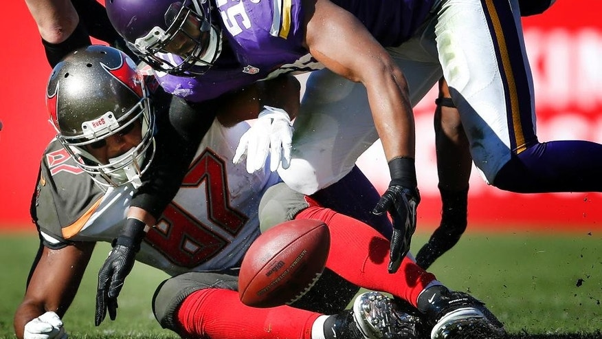 Minnesota Vikings linebacker Anthony Barr (55) goes for a ball fumbled by Tampa Bay Buccaneers tight end Austin Seferian-Jenkins during an NFL football game on Sunday, Oct. 26, 2014, at Raymond James Stadium in Tampa, Fla. The Vikings won 19-13. (AP Photo/The Star Tribune, Carlos Gonzalez) ST. PAUL PIONEER PRESS OUT, MINNEAPOLIS-AREA TV OUT, MAGS OUT