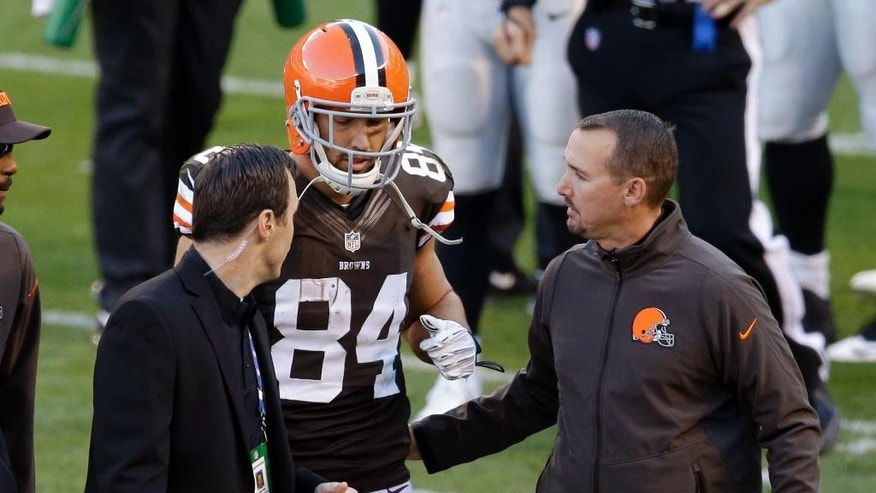 Cleveland Browns tight end Jordan Cameron (84) is helped off the field after an injury in the second quarter of an NFL football game against the Oakland Raiders, Sunday, Oct. 26, 2014, in Cleveland. Cameron left the game, won by the Browns 23-13, with concussion symptoms. (AP Photo/Tony Dejak)