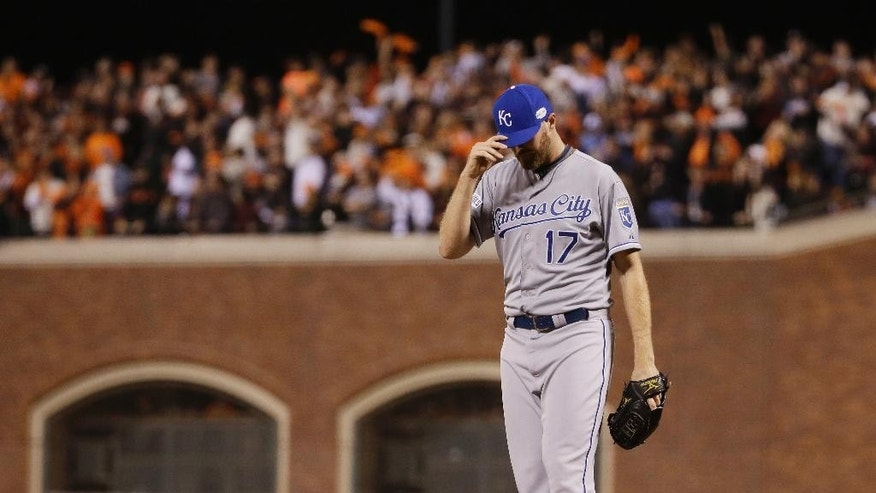 Kansas City Royals pitcher Wade Davis reacts after giving up a two-run RBI double to San Francisco Giants Juan Perez during the eighth inning of Game 5 of baseball's World Series Sunday, Oct. 26, 2014, in San Francisco. (AP Photo/Matt Slocum)