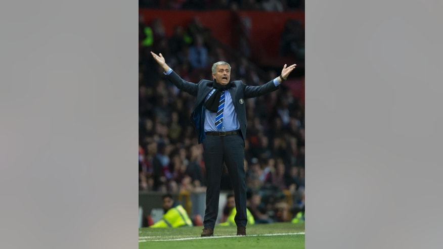 Chelsea's manager Jose Mourinho reacts after a missed opportunity during his team's English Premier League soccer match between Manchester United and Chelsea at Old Trafford Stadium, Manchester, England, Sunday Oct. 26, 2014. (AP Photo/Jon Super)