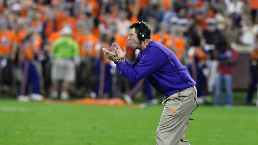 Clemson head coach Dabo Swinney reacts after a play during the first half an NCAA college football game against Syracuse in Clemson, S.C.,  Saturday, Oct. 25, 2014. (AP Photo/ Richard Shiro)