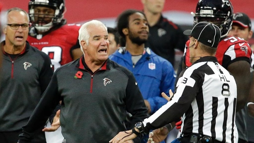 Atlanta Falcons head coach Mike Smith argues with an official in the second half of the NFL football game against the Detroit Lions at Wembley Stadium, London, Sunday, Oct. 26, 2014. The Lions won 22-21.  (AP Photo/Matt Dunham)