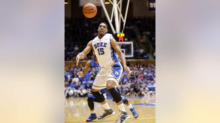In this Saturday, Oct. 25, 2014, photo, Duke's Jahlil Okafor (15) chases the ball during an NCAA college basketball scrimmage at Cameron Indoor Stadium in Durham, N.C.  With a lineup stacked with four blue-chip freshmen talented enough to jump to the NBA after one year, these Blue Devils look an awful lot like some recent Kentucky teams. (AP Photo/Gerry Broome)
