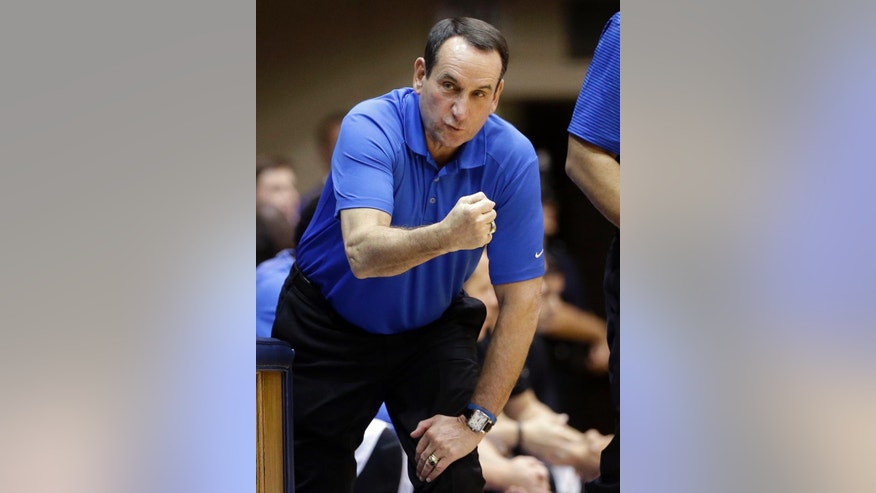 In this Saturday, Oct. 25, 2014, photo, Duke coach Mike Krzyzewski talks to his team during an NCAA college basketball scrimmage at Cameron Indoor Stadium in Durham, N.C.  With a lineup stacked with four blue-chip freshmen talented enough to jump to the NBA after one year, these Blue Devils look an awful lot like some recent Kentucky teams. (AP Photo/Gerry Broome)