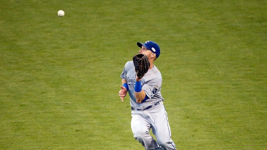 Kansas City Royals' Alex Gordon catches a fly ball hit by San Francisco Giants' Gregor Blanco during the third inning of Game 5 of baseball's World Series Sunday, Oct. 26, 2014, in San Francisco. (AP Photo/Charlie Riedel)