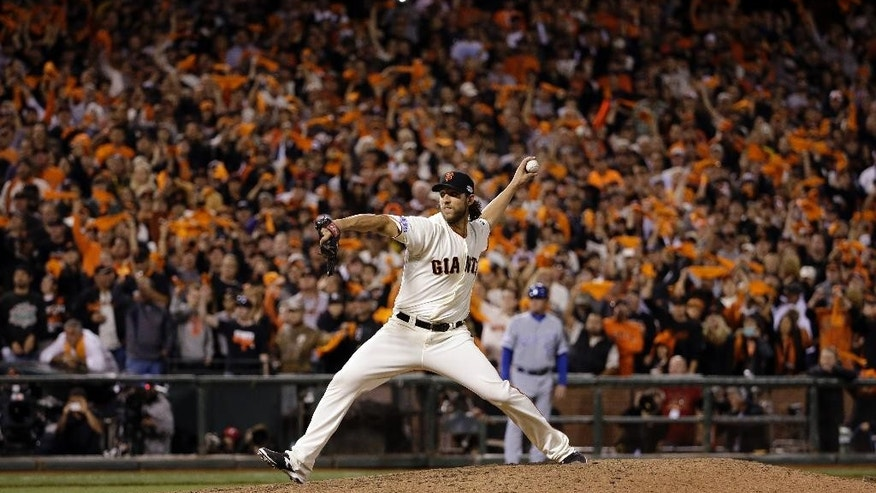 San Francisco Giants pitcher Madison Bumgarner throws during the eighth inning of Game 5 of baseball's World Series against the Kansas City Royals Sunday, Oct. 26, 2014, in San Francisco. (AP Photo/David J. Phillip)