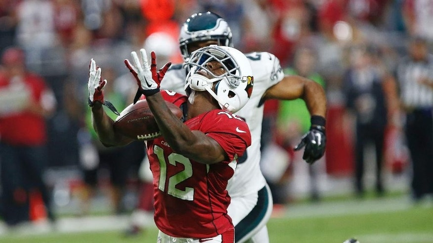 Arizona Cardinals wide receiver John Brown (12) catches a touchdown pass against the Philadelphia Eagles during the second half of an NFL football game, Sunday, Oct. 26, 2014, in Glendale, Ariz. The Cardinals won 24-20. (AP Photo/The Arizona Republic, Rob Schumacher)