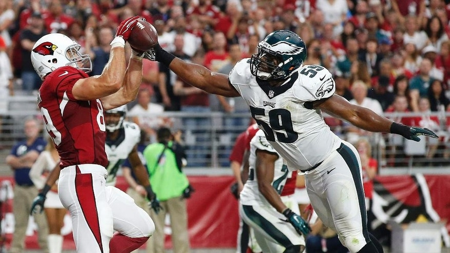 Philadelphia Eagles' DeMeco Ryans (59) strips the ball away from Arizona Cardinals' John Carlson (89) in the end zone during the second half of an NFL football game Sunday, Oct. 26, 2014, in Glendale, Ariz.  The Cardinals won 24-20. (AP Photo/Ross D. Franklin)