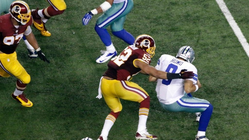 Dallas Cowboys' Tony Romo (9) is sacked by Washington Redskins' Keenan Robinson (52) during the second half of an NFL football game, Monday, Oct. 27, 2014, in Arlington, Texas. Romo was injured on the play and left the game. (AP Photo/Roger Steinman)