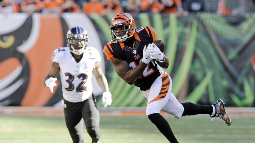 Cincinnati Bengals wide receiver Mohamed Sanu makes a catch in front of Baltimore Ravens defensive back Dominique Franks on the Bengals final drives during the second half of an NFL football game in Cincinnati, Sunday, Oct. 26, 2014. (AP Photo/Al Behrman)