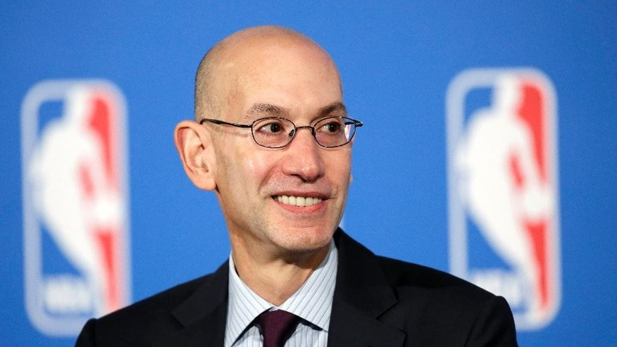 FILE - In this Oct. 6, 2014, file photo, NBA Commissioner Adam Silver answers questions at a news conference after a deal was announced between the league and TV networks in New York. New television contracts are going to inject a huge cash infusion into the league, and owners, executives, players and agents are all on pins and needles trying to anticipate what fiscal life will look like in the new NBA. (AP Photo/Mark Lennihan, File)