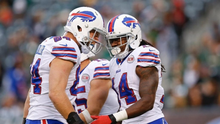 Buffalo Bills tight end Scott Chandler (84) celebrates with teammate Sammy Watkins (14) after Watkins scored a touchdown during the second half of an NFL football game against the New York Jets, Sunday, Oct. 26, 2014, in East Rutherford, N.J. The Bills won the game 43-23. (AP Photo/Kathy Willens)