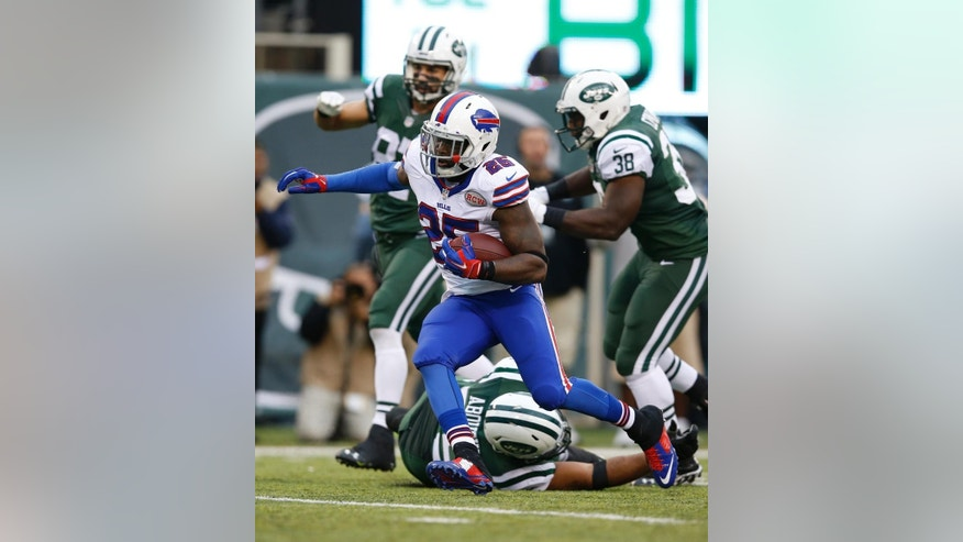 Buffalo Bills strong safety Da'Norris Searcy (25) runs past New York Jets' Oday Aboushi (75) after intercepting a pass during the second half of an NFL football game, Sunday, Oct. 26, 2014, in East Rutherford N.J. The Bills won the game 43-23. (AP Photo/Kathy Willens)