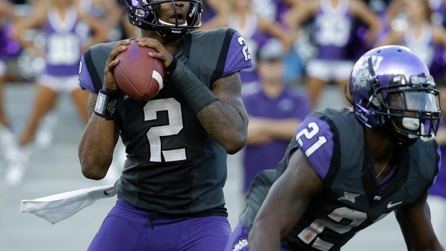 TCU quarterback Trevone Boykin (2) drops back to pass as running back Kyle Hicks (21) provides protection in the second half of an NCAA college football game against Texas Tech, Saturday, Oct. 25, 2014, in Fort Worth, Texas. Boykin threw a school-record seven touchdown passes and No. 10 TCU showcased a new fast-paced offense by scoring the most points in its history in an 82-27 rout of Texas Tech on Saturday. (AP Photo/Tony Gutierrez)
