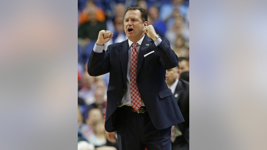 FILE - In this March 14, 2014, file photo, North Carolina State head coach Mark Gottfried cheers on his team during the second half of a quarterfinal NCAA college basketball game against Syracuse at the Atlantic Coast Conference tournament in Greensboro, N.C. (AP Photo/Gerry Broome)
