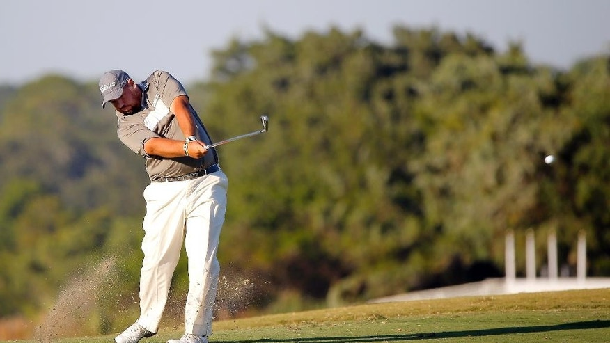Brendon de Jonge, of Zimbabwe, hits off the 18th fairway during a three-way playoff in the final round of the McGladrey Classic golf tournament on Sunday, Oct. 26, 2014, in St. Simons Island, Ga. (AP Photo/Stephen B. Morton)
