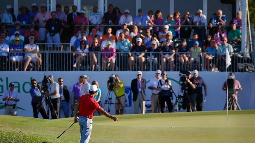 Will MacKenzie reacts after missing a birdie putt on the 18th green during the final round of the McGladrey Classic golf tournament on Sunday, Oct. 26, 2014, in St. Simons Island, Ga. (AP Photo/Stephen B. Morton)