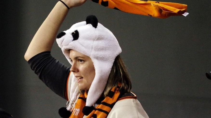 A fan cheers during the ninth inning of Game 5 of baseball's World Series between the Kansas City Royals and the San Francisco Giants on Sunday, Oct. 26, 2014, in San Francisco. The Giants beat the Royals 5-0 to lead the series 3-2. (AP Photo/Charlie Riedel)