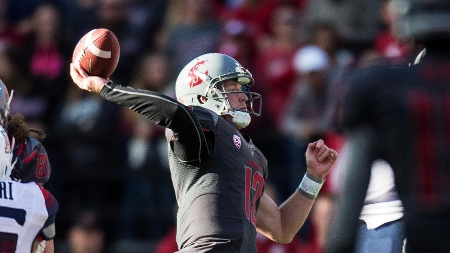 Washington State quarterback Connor Halliday throws a pass against Arizona during the first quarter of an NCAA college football game Saturday, Oct. 25, 2014, at Martin Stadium in Pullman, Wash. (AP Photo/Dean Hare)