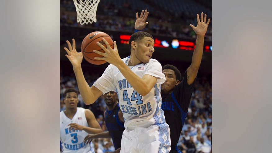 North Carolina's Justin Jackson (44) pulls in a defensive rebound in the first half against Fayetteville State during an NCAA college basketball exhibition game Friday, Oct. 24, 2014, Chapel Hill, N.C.  (AP Photo/The News & Observer, Robert Willett)