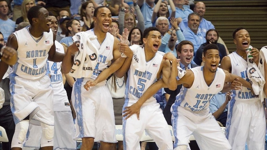 North Carolina's Theo Pinson (1), Brice Johnson (11), Marcus Paige (5), J.P. Tokoto (13) and Nate Britt (0) react after teammate Justin Coleman scored in the final minutes against Fayetteville State in an NCAA college basketball exhibition game Friday, Oct. 24, 2014, in Chapel Hill, N.C. North Carolina won 111-58. (AP Photo/The News & Observer, Robert Willett)